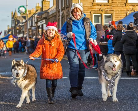 Lorna Simpson and Emmy Grant with their huskies in the Buckie Christmas Kracker parade.