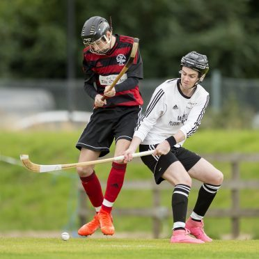 Daniel MacCuish, left, in action for Oban