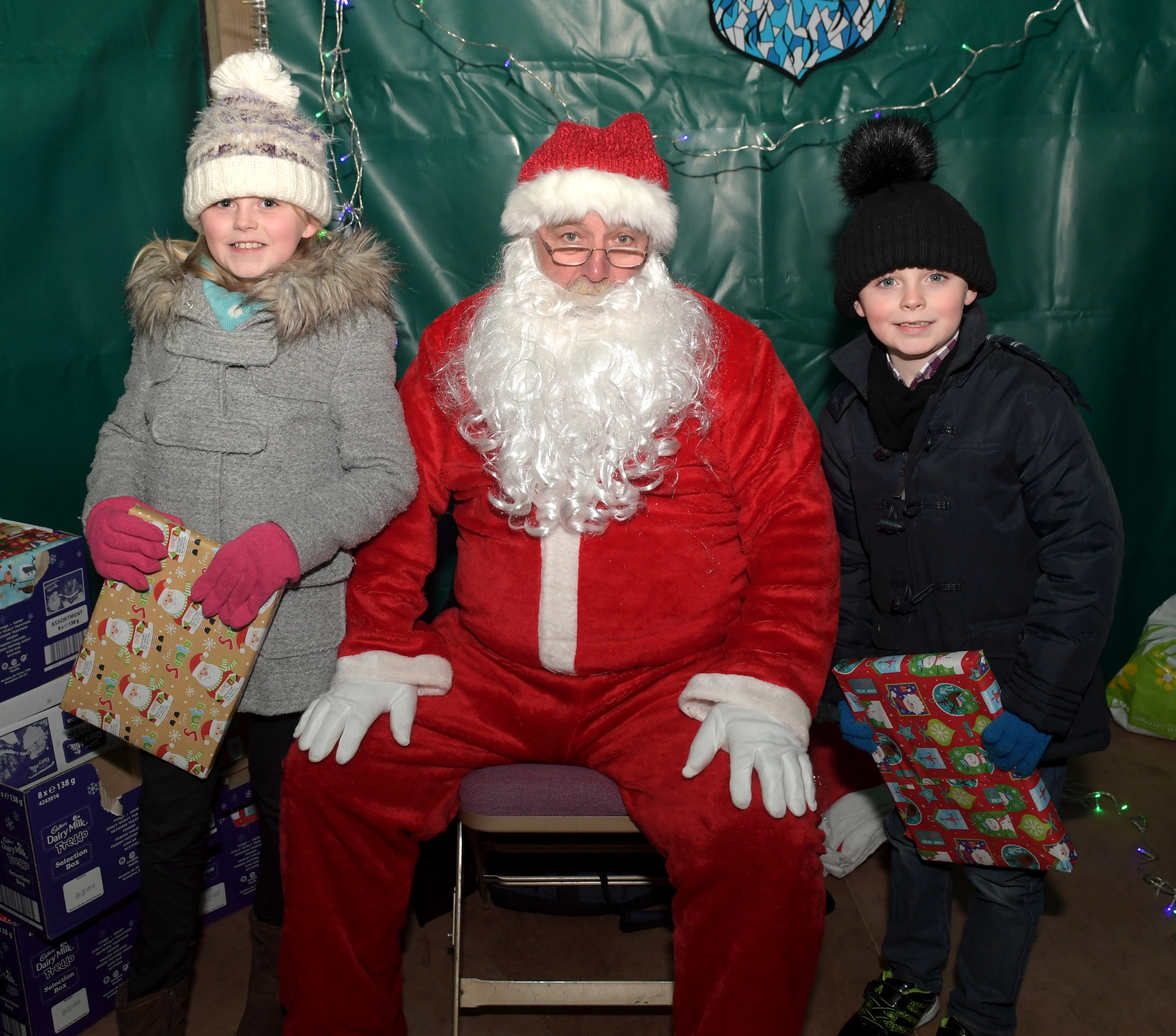 Iverurie Christmas Lights Switch On. From left, Ellie and Jack Smith with Santa. Picture by Kath Flannery