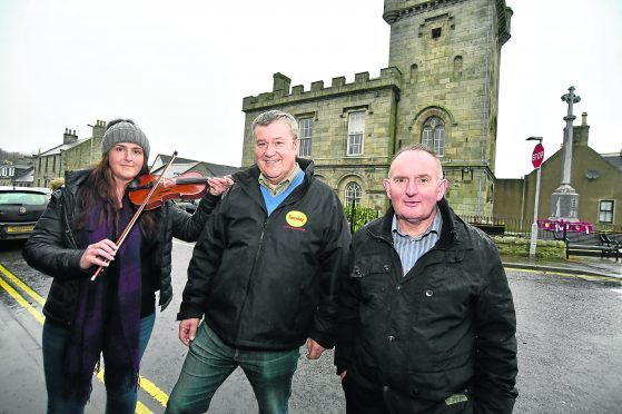 (L TO R) SARAH-JAYNE MORRICE FROM THE BUCHAN HERITAGE SOCIETY AND CHAIRMAN ROBERT CHAPMAN AND DIRECTOR HEBBIE FOWLIE FROM THE STRICHEN COMMUNITY PARK AT THE TOWN HALL.