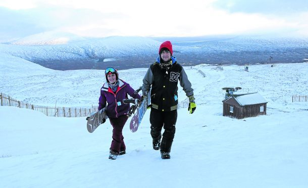 L- R Debbie Rooke and David Crammond who were among the first people to snow board at Glencoe mountain resort this winter.