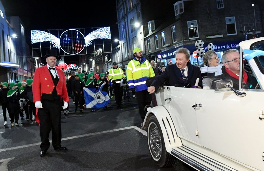 Denis Law with his wife Diana during the parade.