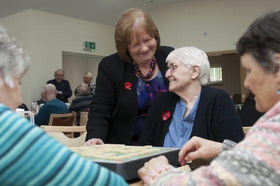 Mental Health Minister Maureen Watt, standing, visits the Harvest Centre in Elgin.