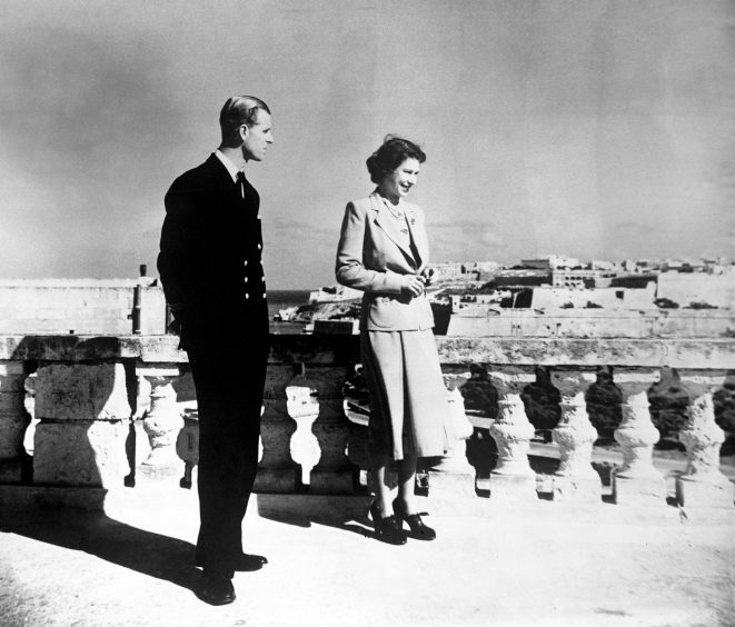 Princess Elizabeth, accompanied by the Duke of Edinburgh,m looking over Valetta from the roof of the Villa  Guardamangia, Malta. November 1949.