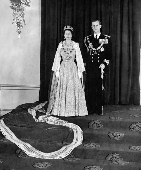 Queen Elizabeth II and Duke of Edinburgh in the Throne Room of Buckingham Palace, after they returned from the Queens first State Opening of Parliament. November 1952.