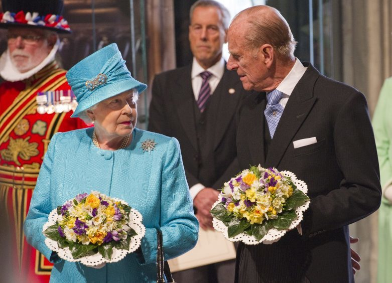 Queen Elizabeth II and the Duke of Edinburgh attending the traditional Royal Maundy Service at Westminster Abbey on her 85th birthday. April 2011.