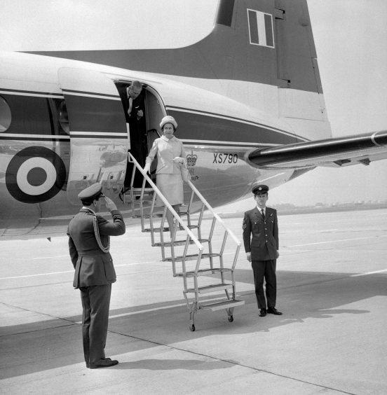 Queen Elizabeth II and the Duke of Edinburgh at Heathrow Airport. July 1971.