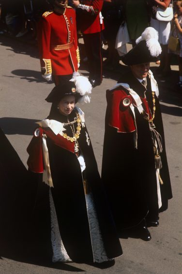 Queen Elizabeth II and the Duke of Edinburgh in the procession to St George's Chapel, Windsor, for the Service of Thanksgiving for the Most Noble Order of the Garter. June 1973.
