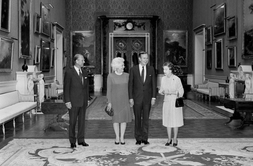 US President George Bush, his wife Barbara, the Duke of Edinburgh and Queen Elizabeth II, in the picture room at Buckingham Palace. June 1989.