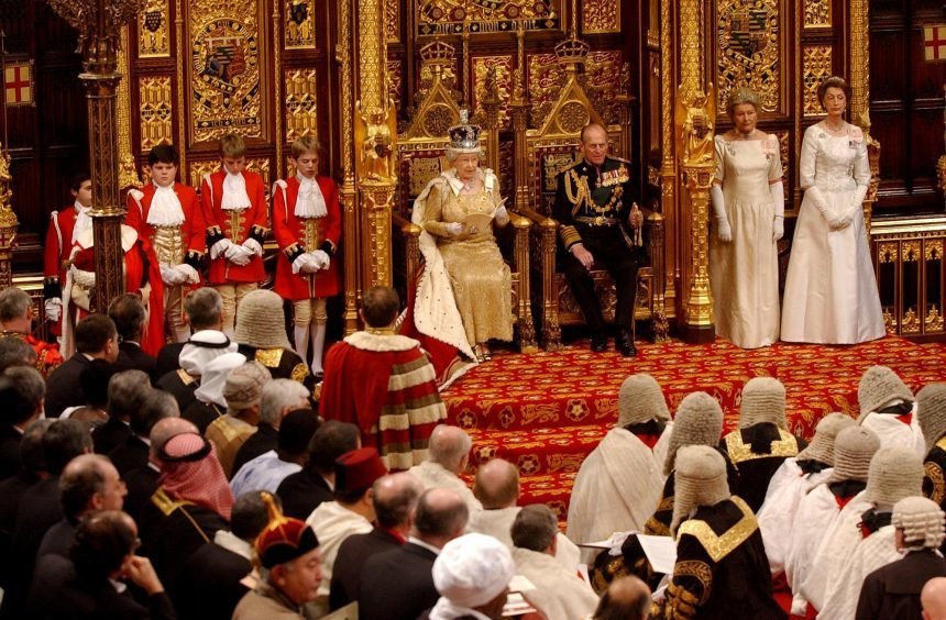Queen Elizabeth II, with the Duke of Edinburgh, making her speech at the State Opening of Parliament in The House of Lords in London. November 2004.