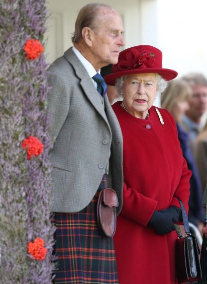 The Duke of Edinburgh and Queen Elizabeth II during the Braemar Royal Highland Gathering, held a short distance from the Balmoral estate in Aberdeenshire. September 2015.