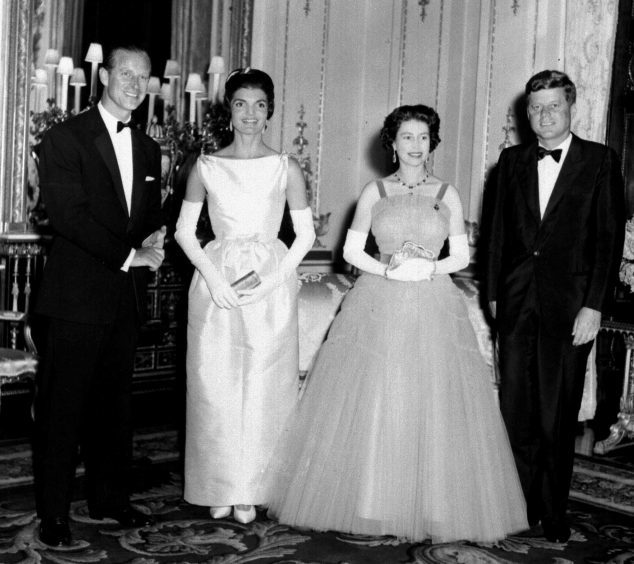 American President John F Kennedy and his wife Jacqueline, pictured with Queen Elizabeth II and the Duke of Edinburgh at Buckingham Palace. June 1961.