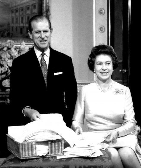 Queen Elizabeth II and the Duke of Edinburgh in the Belgian suite of Buckingham Palace. November 1987.
