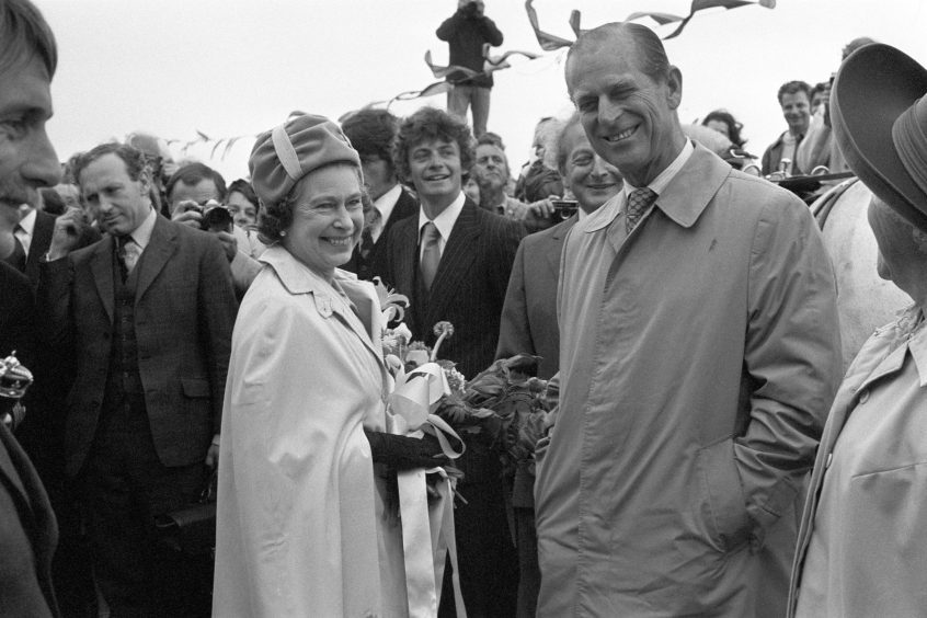 Queen Elizabeth II and the Duke of Edinburgh on the jetty at Maseline harbour during their visit to the island of Sark, Channel Islands. June 1978.