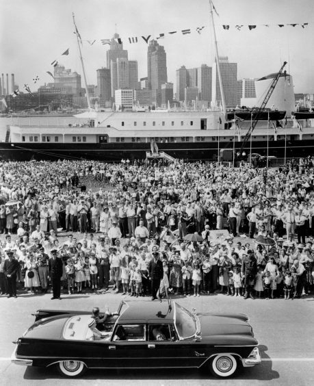 Queen Elizabeth II and the Duke of Edinburgh, with the Royal Yacht Britannia seen in the background, during the Royal Tour of Canada. July 1959.