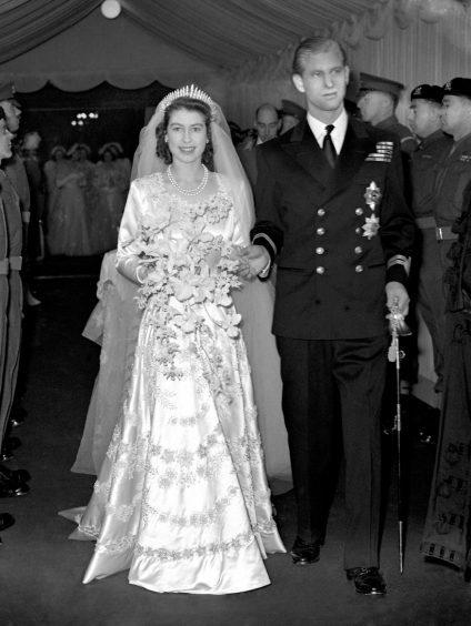 Princess Elizabeth and the Duke of Edinburgh leaving Westminster Abbey after their wedding ceremony. November 1947