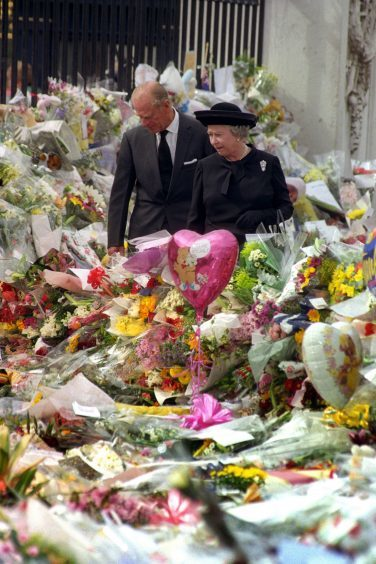 Queen Elizabeth II and the Duke of Edinburgh viewing the floral tributes to Diana, Princess of Wales, at Buckingham Palace. September 1997.