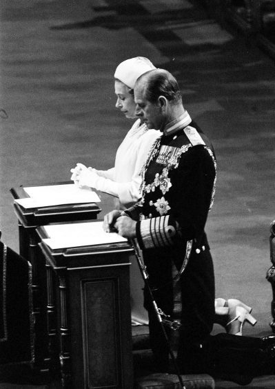 Queen Elizabeth II and the Duke of Edinburgh kneeling in St Pauls Cathedral during the special thanksgiving service to mark her Silver Jubilee. June 1977.