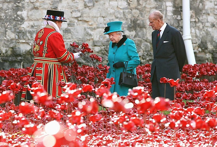 Queen Elizabeth II and the Duke of Edinburgh visit the Tower of London's Blood Swept Lands and Seas of Red installation. October 2014.
