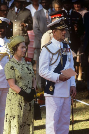 Queen Elizabeth II and the Duke of Edinburgh during the Remembrance Day ceremony at Nairobi's Commonwealth Cemetery. November 1983.