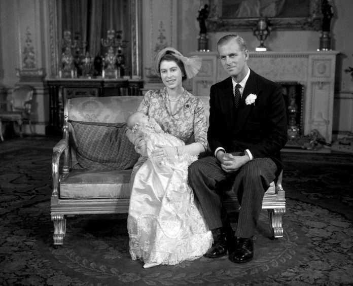 Princess Elizabeth and the Duke of Edinburgh with their daughter Princess Anne after her christening at Buckingham Palace. October 1950.