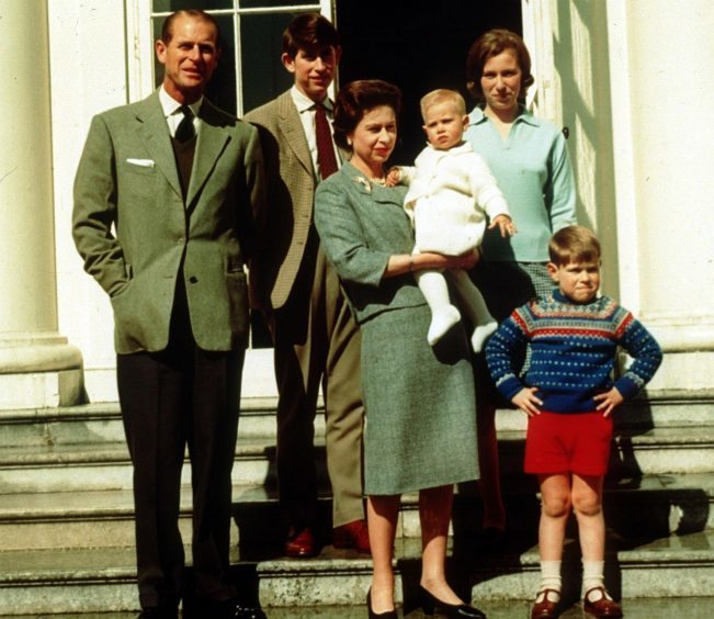 Queen Elizabeth II holding Prince Edward and surrounded by her family, (left to right), the Duke of Edinburgh, Prince Charles, Princess Anne, and Prince Andrew at Windsor on the occasion of the Queen's 39th birthday. April 1965.