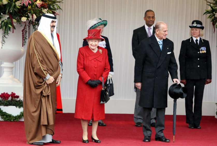 Queen Elizabeth II and the Duke of Edinburgh welcoming the Emir of Qatar Sheikh Hamad bin Khalifa al Thani (left) to Windsor Castle, Berkshire, during his state visit to the UK. October 2010.