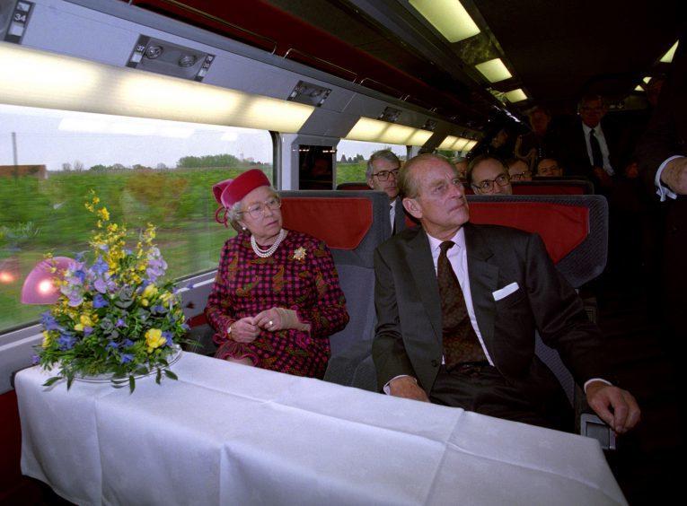 Queen Elizabeth II and the Duke of Edinburgh travelling on the new Eurostar train. May 1994