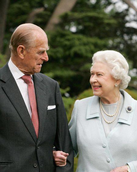 Queen Elizabeth II and the Duke of Edinburgh in the grounds of Broadlands on their Diamond wedding anniversary. November 2007.