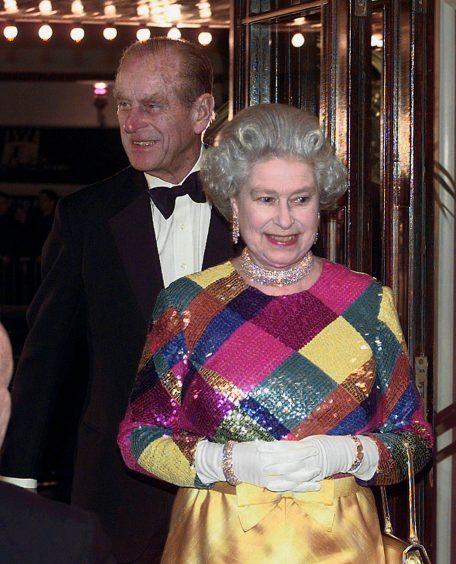 Queen Elizabeth II and the Duke of Edinburgh arriving at the Birmingham Hippodrome for the 1999 Royal Variety Performance. November 1999.