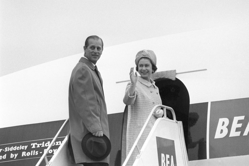 Queen Elizabeth II and the Duke of Edinburgh boarding Trident airliner of British European Airways at Heathrow Airport to travel to Malta for a four-day visit. November 1967.