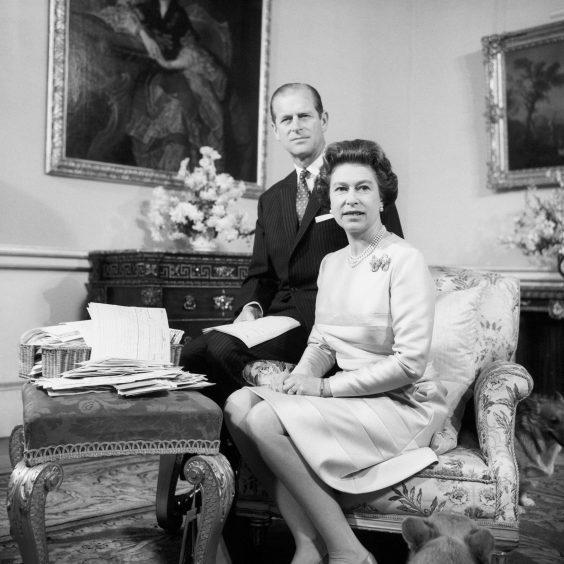 Queen Elizabeth II and the Duke of Edinburgh celebrating their Silver Wedding Anniversary in the Belgian suite in Buckingham Palace. November 1972.