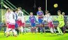 Inverness' Brad McKay (second from left) scores from a header to make it 1-0
