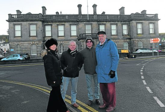 From left, Isabell Munn, Jim Douglas, John Robson and David Fleming are pictured at the old courthouse in Stonehaven, which is being bought by the community partnership.