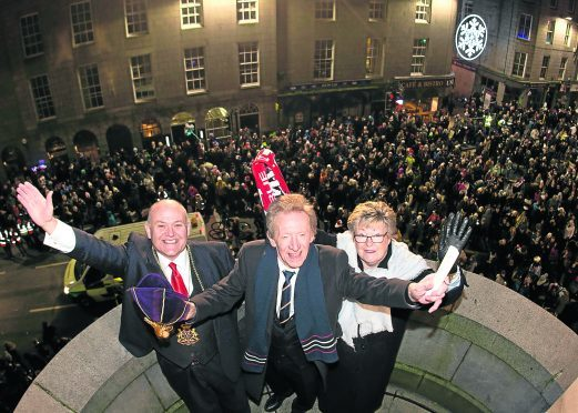 Denis and Di Law on balcony with Lord Provost Barney Crockett.