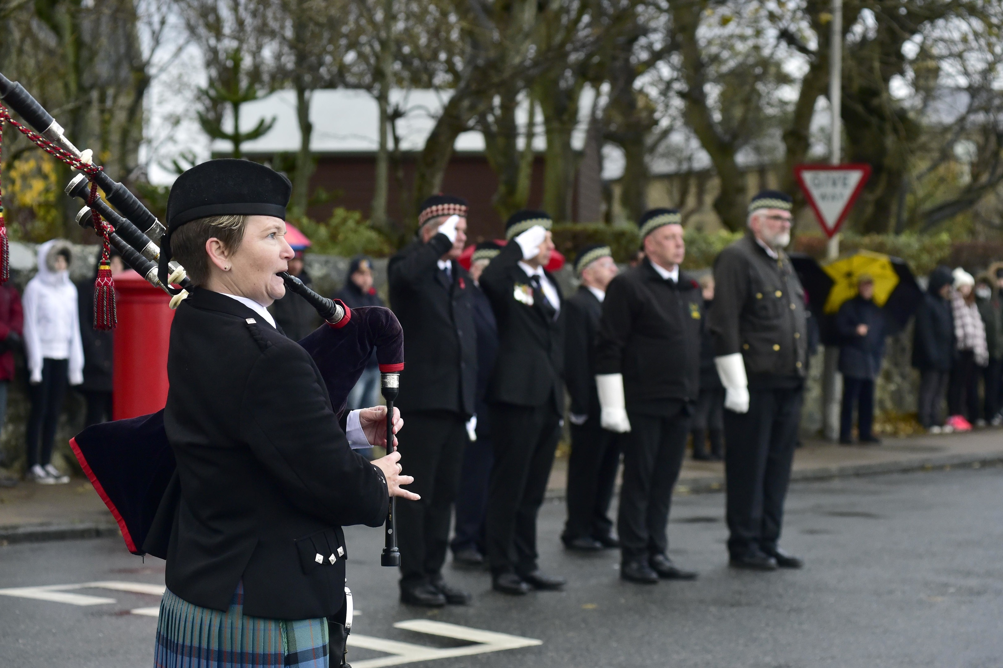Pipe Major Denise Buchan plays at the Fraserburgh remembrance service.