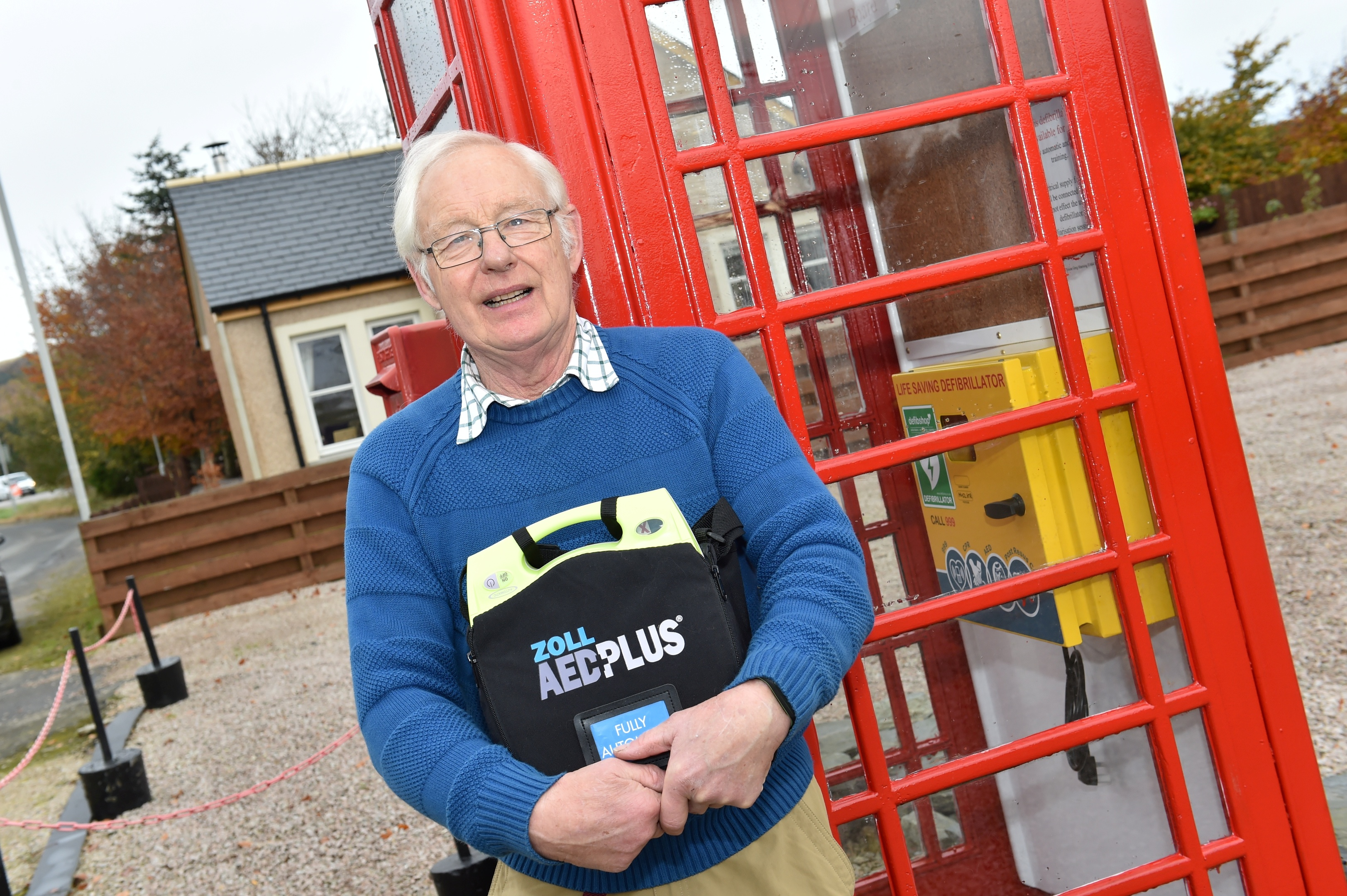 The phone box in Colpy which is now housing a new defibrillator. Greg Manning who restored the phone box with the new device. Picture by Colin Rennie