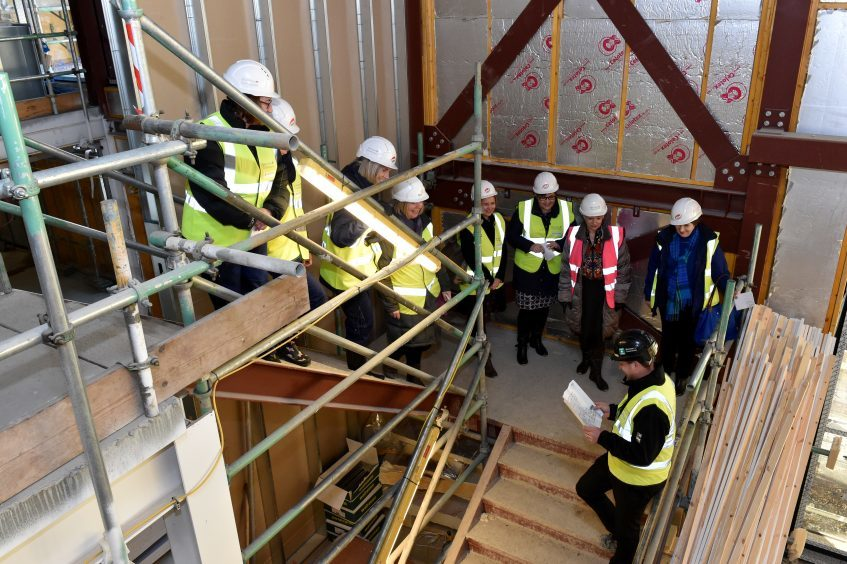 NHS health workers are shown round the site by assistant site manager Michael Cleavin.