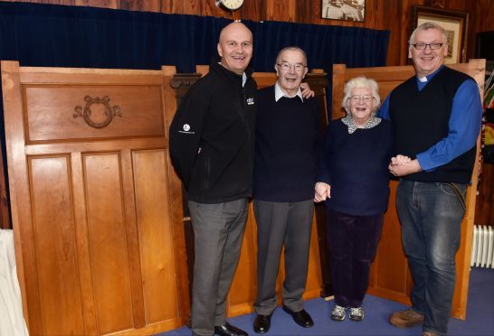 Ballater retired joiner Ian Hepburn (second left) pictured with (from left) North Contracts director Lee Garden, Ian's wife Sheena and Rev David Barr (Picture: Colin Rennie)