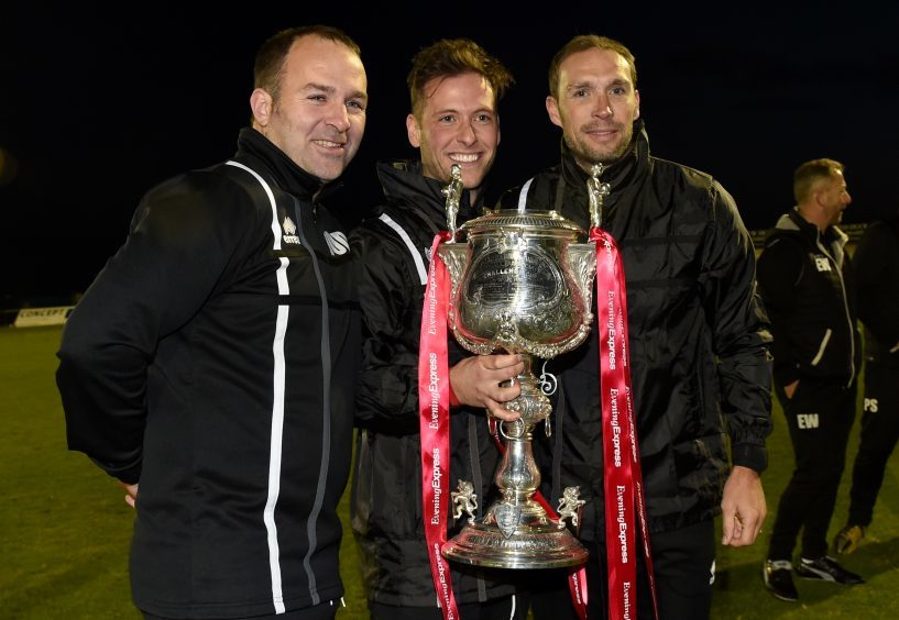 Formartine manager, Paul Lawson celebrates the cup win.
