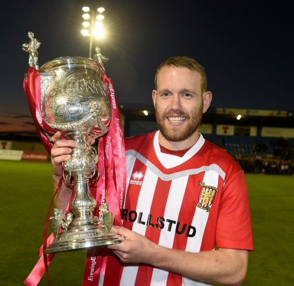 Goal scorer, Garry Wood with the cup.