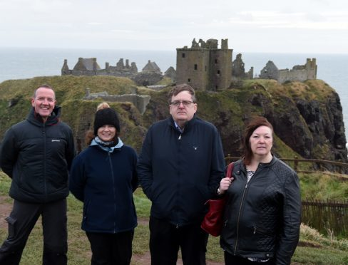 Stonehaven residents angry that they have not been included in NE250 list. In the picture at Dunnottar castle are from left: Jim Wands, cusodian of castle, Isabel Munn, Stonehaven town partnership, Simon Cruickshank, Ship Inn and Sheila Howarth, Belvedere Hotel.  Picture by Jim Irvine  8-11-17
