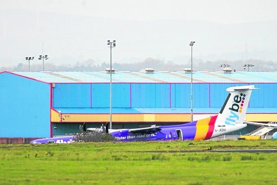 The Flybe BE331 plane on the tarmac after it landed with no nose gear at Belfast International Airport.