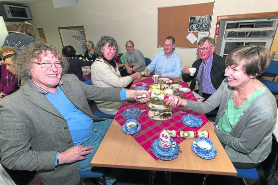 Some of the Befriending Caithness volunteers enjoy their Christmas party in Telford House, Wick
