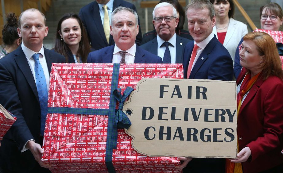 The campaign for fair delivery charges received cross-party support in the Scottish Parliament.