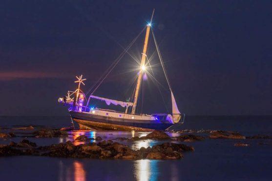 The boat is stranded in Stonehaven Bay