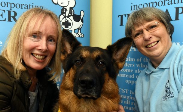 From left to right, Rona Meldrum, Bruno the dog and Fiona Watts from Therapet.   Picture by Jim Irvine