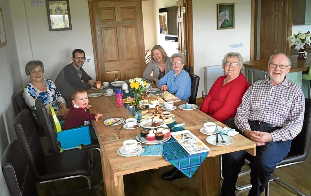 The Irvine family hosting a tea party for Contact the Elderly