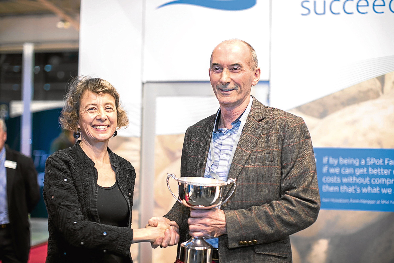 AHDB Potatoes chairman Sophie Churchill presents an award to Jim Aiken