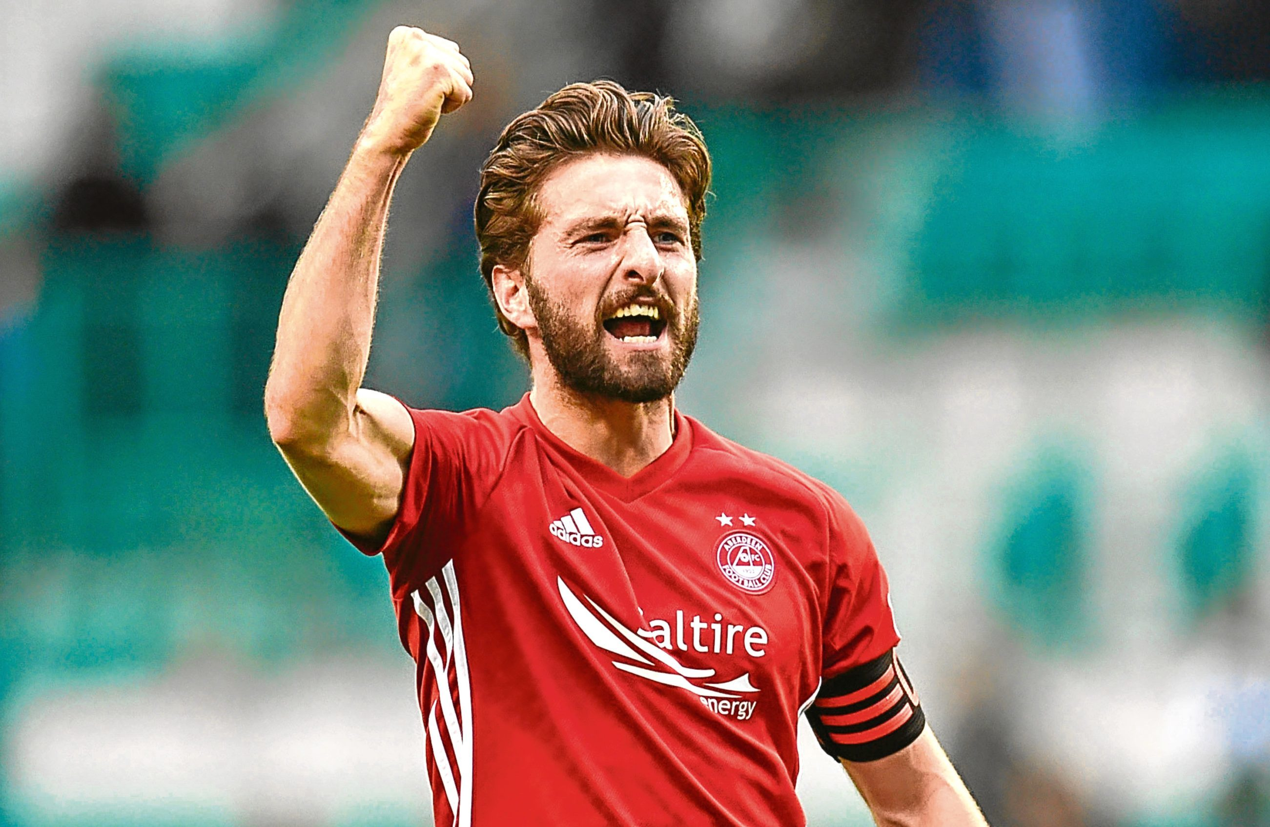 Aberdeen captain Graeme Shinnie is back in the squad after suspension.
